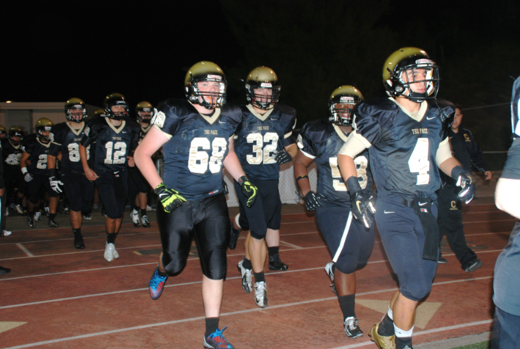 Varsity+football+strives+for+victory+